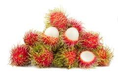 Rambutansfrukt som isoleras på vit Arkivfoto