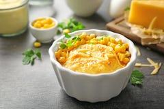 Ramekin with corn pudding. On table stock photos