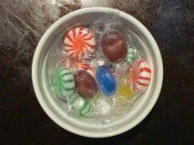 Ramekin of wrapped hard candies stock photo
