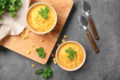 Ramekins with corn pudding. On table royalty free stock image