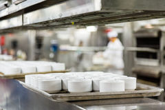 Ramekins on Line in Commercial Kitchen Stock Photos