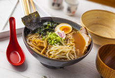 Ramen Asian noodles. Miso Ramen Asian noodles with meat and egg in bowl on white wooden background stock photo