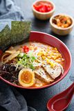 Ramen bowl with noodles and pork. Ramen bowl with noodles, pork, boiled egg and vegatables stock photography
