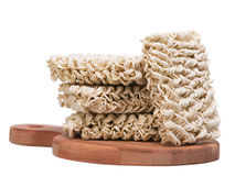 Ramen instant raw noodles on wooden plank 3/4. General view Stock Photo