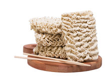 Ramen instant raw noodles on wooden plank 3/4 with chopsticks Stock Image