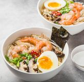 Ramen noodle soup with prawn, shiitake mushroms and egg in white Royalty Free Stock Photography
