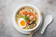 Ramen noodle soup with prawn, shiitake mushroms and egg in white Stock Images