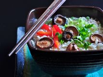Ramen noodles with shiitake mushrooms, green peas, sweet pepper and coriander Stock Image
