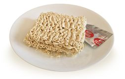 Ramen Noodles Uncooked with Beef Flavor Packet. On Plate  Japanese Cooking Stock Image