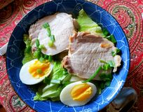 Ramen soup in a blue boul. Japanese ramen soup with pork, eggs, green leaves of cabbage in a blue bowl Royalty Free Stock Image