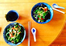 Ramen soup. Two bowls of Ramen soup chopsticks table food happy spoons Stock Photos