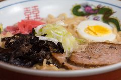 Ramen tonkotsu with pork, soy milk, pork broth,.black mushrooms, eggs, onions stock photos