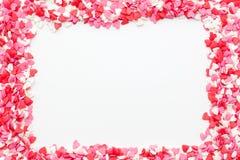 Ramen utgöras av många små hjärtor på en vit bakgrund Royaltyfri Foto