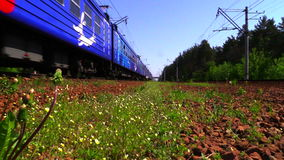 RAMENSKOE, MOSCOW REGION, RUSSIA - MAY 18, 2014: Suburban train REKS rides to the station. Russian railway.Full HD video. Shooting at 50 fps stock footage