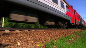 RAMENSKOE, MOSCOW REGION, RUSSIA - MAY 18, 2014: Suburban train RZD (russian railway). Russian railway. Low angle shooting. Full HD video. Shooting at 50 fps stock video