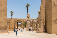 Statue of Ramesses II with his daughter, princess Bintanath, Luxor, Egypt royalty free stock photos