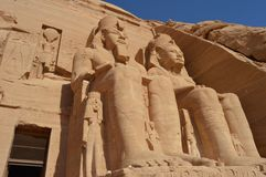 Ramesses II sits at Abu Simbel. The different eras of Ramesses are depicted at Abu Simbel with each sculpture detailing his physical appearance at the different Royalty Free Stock Image
