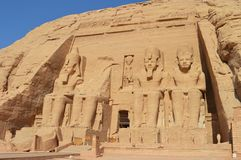 Ramesses II sits at Abu Simbel. The different eras of Ramesses are depicted at Abu Simbel with each sculpture detailing his physical appearance at the different Stock Image