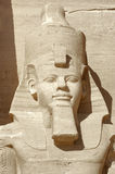 Ramesses portrait at Abu Simbel temples. Architectural detail of the historic Abu Simbel temples in Egypt (Africa) showing a sculpture of Ramesses 2nd in sunny Royalty Free Stock Photos