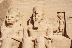 Ramesses the second or Ramesses the Great and Horus statues carved in rock at Abu Simbel Temple. Egyptian civilization history well preserved at one of the stock photos