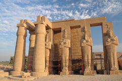 Ramesseum. Giant Osiris statues in the second court of the Ramesseum undergoing renovation work, at the ancient egyptian mortuary temple of Ramses II at thebes Stock Photo