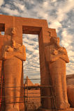 Ramesseum. Giant Osiris statues in the evening light at the Ramesseum, the ancient egyptian mortuary temple of Ramses II at thebes near Luxor, Egypt Stock Image