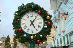 Rami dell'orologio e dell'abete di Natale Fotografia Stock