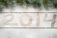 Rami di albero dell'abete e 2014 Immagini Stock
