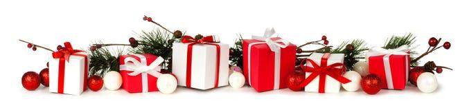 Rami di Natale e confine del regalo Fotografie Stock Libere da Diritti