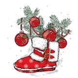 Rami di un albero di Natale negli stivali del ` s del nuovo anno ` S del nuovo anno e Natale Inverno Immagine Stock