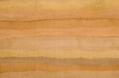 Rammed Earth Wall. The striations, natural earthtone colors, and textures of a rammed earth wall, the latest ecological building material Royalty Free Stock Image