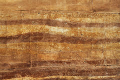 Rammed earth wall material texture. Background Stock Images