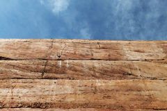 Rammed earth wall material texture on sky background. Rammed earth wall material texture on blue sky background Royalty Free Stock Images