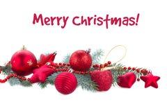 Ramo de árvore do abeto e decorações vermelhas do Natal Fotos de Stock Royalty Free