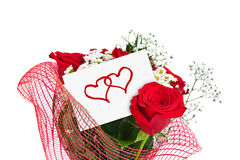Ramo de las rosas y tarjeta de papel Imagen de archivo