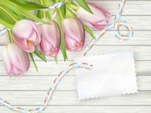 Ramo de tulipanes en el tablero de madera rústico EPS 10 Fotografía de archivo