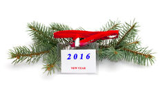 Ramo dell'abete ed etichetta con un'iscrizione 2016 nuovi anni, wi Immagine Stock Libera da Diritti