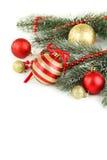 Ramo dell'albero di Natale con le palle isolate su fondo bianco Fotografie Stock