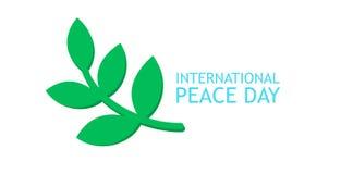 Ramo di ulivo ed insegna per il manifesto internazionale di giorno di pace Fotografia Stock