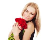 Ramo rojo de las rosas de la explotación agrícola femenina hermosa Foto de archivo libre de regalías