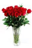 Ramo rojo de las rosas en florero Imágenes de archivo libres de regalías