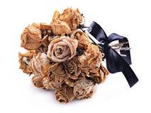 Ramo secado de rosas en el fondo blanco Fotografía de archivo