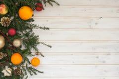 Ramo Spruce com decoração e fruto Imagem de Stock Royalty Free