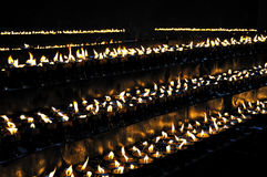 Burning candles in Ramoche Temple. Ramoche Temple is a Buddhist monastery which considered the most important temple in Lhasa after the Jokhang Temple Stock Images