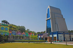 Ramoji Tower at Ramoji Film City. Ramoji Tower with green field and fake colourful building and Hollywood Sign at Ramoji Film City in Hyderabad Stock Image