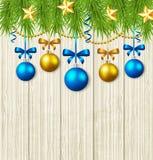 Ramos do abeto, estrelas e quinquilharias azuis Fotografia de Stock Royalty Free
