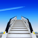 Ramp. Frontal view of white ramp in airport and fly away plane Royalty Free Stock Images
