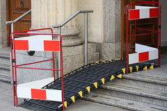 Ramp. A ramp placed over a step to the entrance of a building to assist the delivery of goods as well as access for the less abled Royalty Free Stock Image