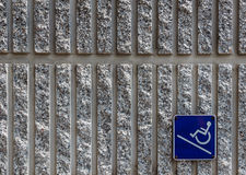 Ramp access sign on concrete wall background. Ramp access sign for the disabled on concrete wall background Royalty Free Stock Photo