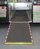 Ramp and door. Door and ramp for wheelchair at city bus Stock Images